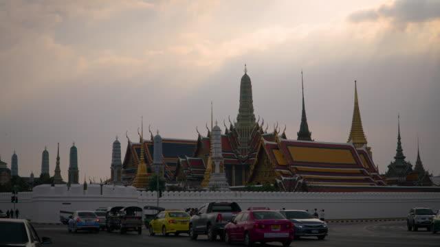 4k timelapse lockdown sunset at Wat Phra Kaeo or Grand Palace in Bangkok, Thailand.