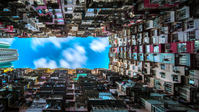 4k timelapse movie moving cloud of low angle view of crowded residential towers in an old community in quarry bay, hong kong - flat stock videos & royalty-free footage