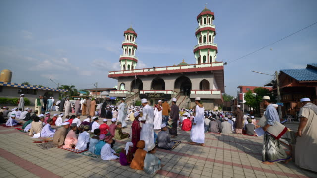4k timelapse movie of people walking outside mosque in hari raya day, hatyai thailand 2018 - month stock videos & royalty-free footage