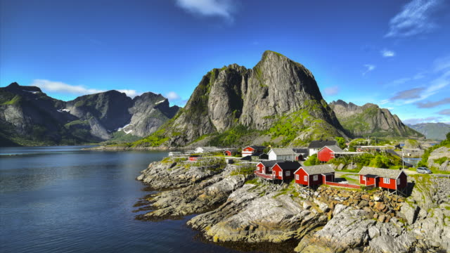 4k time-lapse moving clouds over traditional norwegian fisherman's cabins, rorbuer, on the island of hamnoy, reine, lofoten islands, summer of norway. - cabin stock videos & royalty-free footage