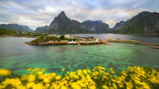 4k time-lapse moving clouds over traditional norwegian fisherman's cabins, rorbuer, on the island of hamnoy, reine, lofoten islands, summer of norway. - traditionally norwegian stock videos & royalty-free footage