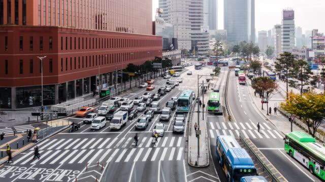 4k Timelapse of car traffic and Crown Pedestrian of people on the road at Seoul station in South Korea