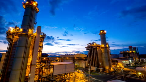 4k timelapse of combined cycle powerplant or fuel gas powerplant - twilight stock videos & royalty-free footage
