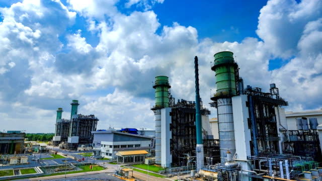 4k timelapse of combined cycle powerplant - gas pipe stock videos and b-roll footage