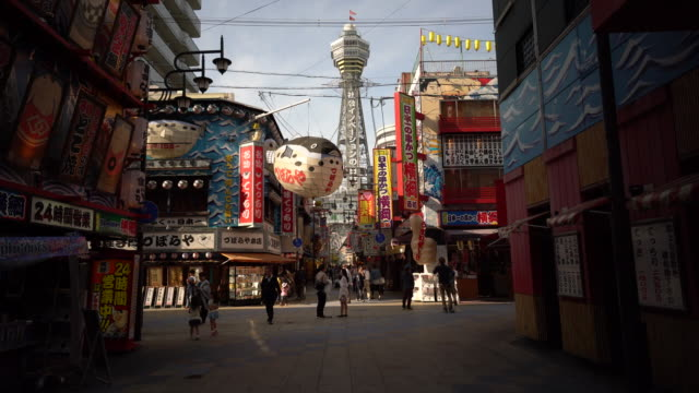 4k timelapse of crowd people at shinsekai district osaka japan - osaka stock videos and b-roll footage