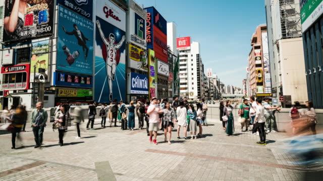 4k timelapse of dontonbori district at osaka japan - calendar date stock videos & royalty-free footage