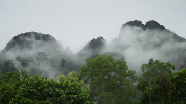 4k time-lapse of misty mountain in laos. - mountain range stock videos & royalty-free footage