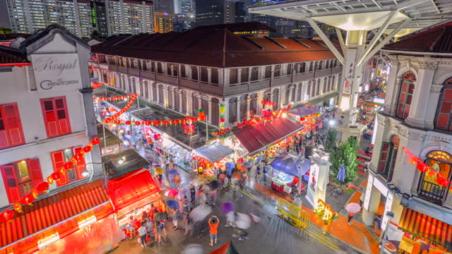 4k Timelapse of People in China town street, Singapore, have many shops and tourism walking for shopping.