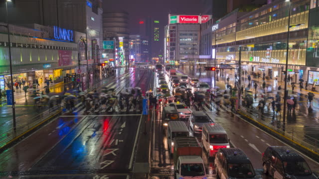4k time-lapse of people walk across the street while it rains - zebra crossing stock videos & royalty-free footage