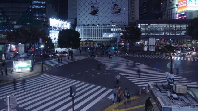 4k time-lapse of shibuya crossing in tokyo, japan. - crossroad stock videos & royalty-free footage
