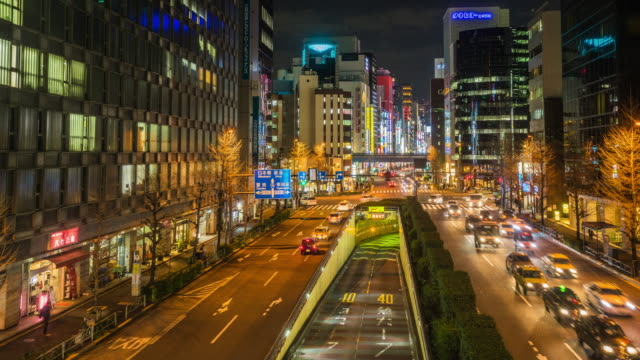 4k time-lapse of Shimbashi commercial and night life district with crowd of people