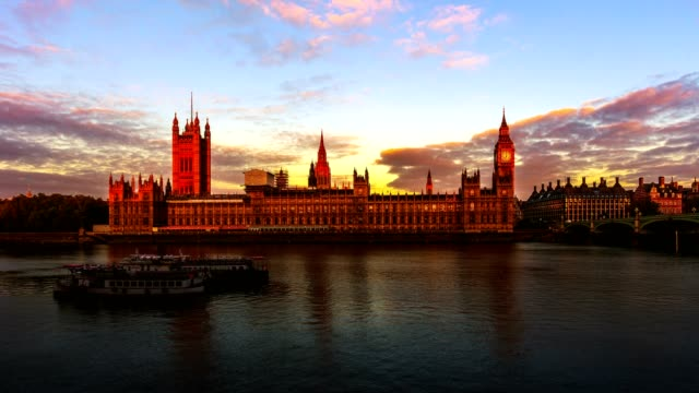 4k timelapse of sunrise at houses of parliament in london - gothic stock videos & royalty-free footage