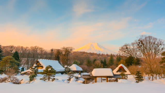 4k time-lapse of sunrise at oshino hakkai village with mount fuji is background after heavy snow storm, winter japan - thatched roof stock videos & royalty-free footage