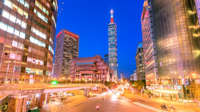 4k timelapse of taipei world trade center and taipei 101 in xinyi business district - taipei 101 stock videos and b-roll footage