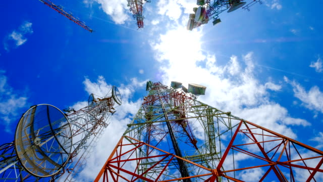 4k timelapse of telecommunication towers and sunlight and beautiful sky - microwave tower stock videos & royalty-free footage