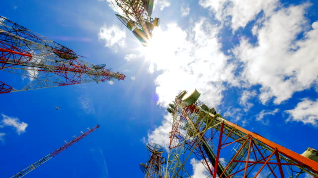 4k timelapse of Telecommunication Towers and sunlight and beautiful sky