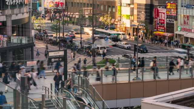 4k timelapse people cross the road at osaka japan - osaka stock videos and b-roll footage
