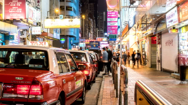 4k timelapse - taxi queue waiting for customer - hong kong stock videos & royalty-free footage