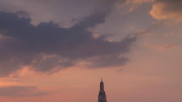 4k timelapse tilt down sunset of Wat Arun Temple in Bangkok, Thailand.