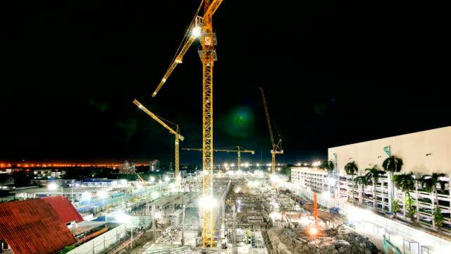 vídeos de stock e filmes b-roll de 4k time-lapse top view of construction site - veículo de construção