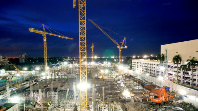 4k time-lapse top view of construction site - construction vehicle stock videos & royalty-free footage