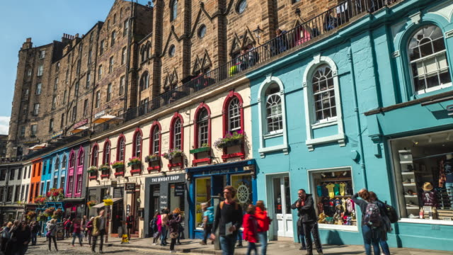 4k time-lapse : tourist at victoria street royal mile in old town edinburgh scotland uk - edinburgh scotland stock videos & royalty-free footage