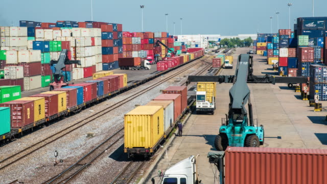 4k time-lapse : train with container in shipyard - unloading stock videos & royalty-free footage
