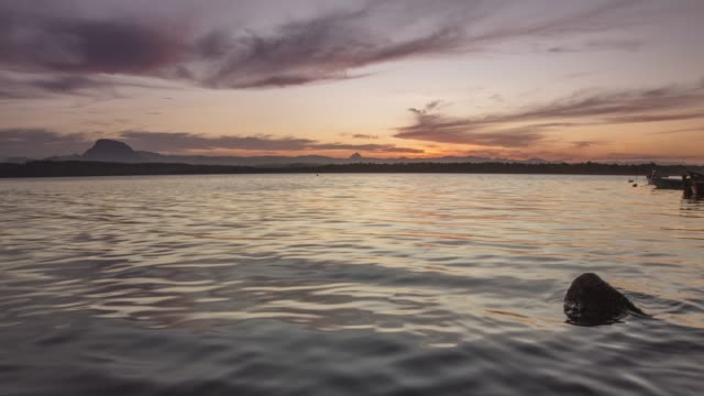 4k タイムラプスビデオ-地平線上の夕日