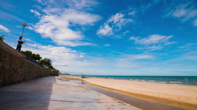 4k, time-lapse view of hua hin beach / pranburi, thailand - digital composite stock videos and b-roll footage