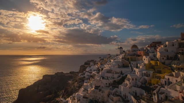 4k timelapse : village oia on santorini island at sunset, greece - oia santorini stock videos & royalty-free footage