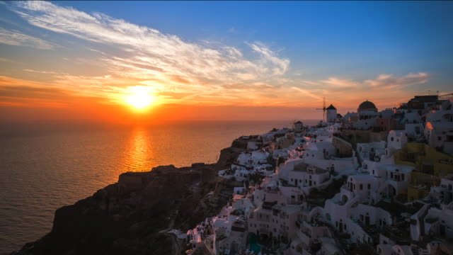 4k timelapse : village oia on santorini island at sunset, zoom in shot, greec - oia santorini stock videos & royalty-free footage