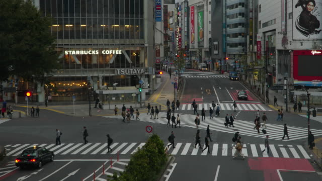 4k time-lapse with medium shot  of shibuya crossing in tokyo, japan. - road junction stock videos & royalty-free footage