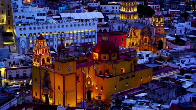 vídeos de stock e filmes b-roll de 4k time-lapse:university temple companiia our lady basilica guanajuato mexico - spire