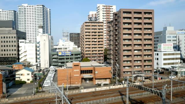 鉄道で 4 k 東京シティー ビュー - 電気部品点の映像素材/bロール
