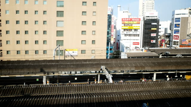 4k tokyo city view in train - rail transportation stock videos & royalty-free footage