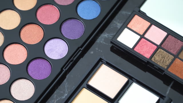 4k top view and turning of make-up palette.