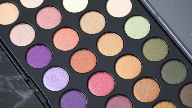 4k top view and turning of make-up palette. - beautician stock videos and b-roll footage