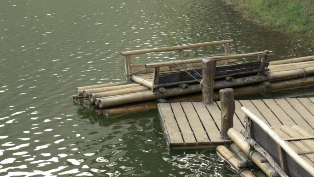 4k: traditional bamboo rafts in lake - wood material stock videos & royalty-free footage