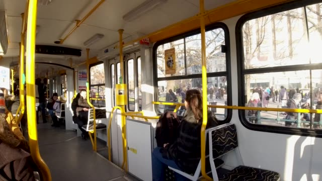 4k traditional public transport tram moves along danube river in budapest hungary - traditionally hungarian stock videos & royalty-free footage