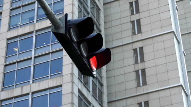 4k traffic light in the city - road signal stock videos & royalty-free footage