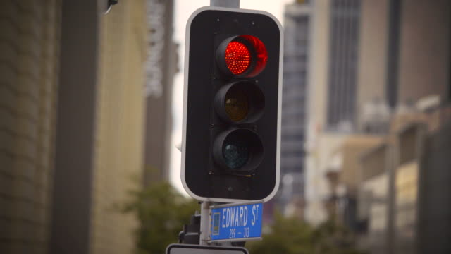 4k traffic signal go.  (changes from red to green) - road signal stock videos & royalty-free footage