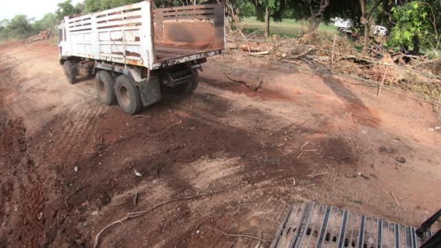 4k truck unloading soils. - sample holder stock videos & royalty-free footage