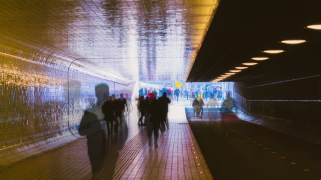 4k uhd timelapse  crowd people walking in tunnel from train station transportation city lifestyle - tunnel stock videos & royalty-free footage