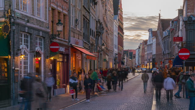 4k uhd timelapse crowd tourists shopping grote market square street historic town at bruges belgium famous destination sunset - belgium stock videos & royalty-free footage
