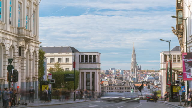 4k uhd timelapse of crowd tourist walk across traffic street with  beautiful cityscape of brussels in a beautiful summer day  belgium, brussels daytimes - town hall government building stock videos & royalty-free footage