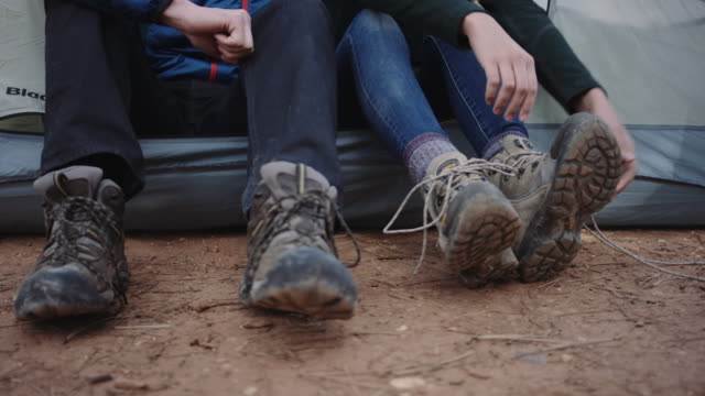 4k uhd: young woman tying her hiking boots - camping stock videos and b-roll footage