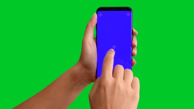 4k using smart phone displaying chroma key blue screen - handheld stock videos & royalty-free footage