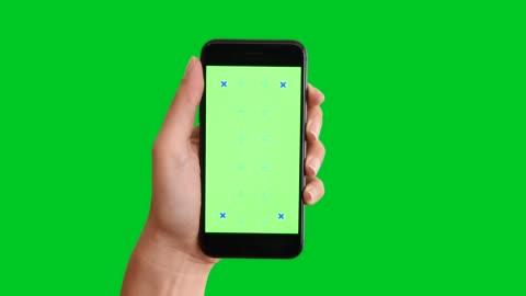 4k using smart phone displaying chroma key on green screen - human hand stock videos & royalty-free footage