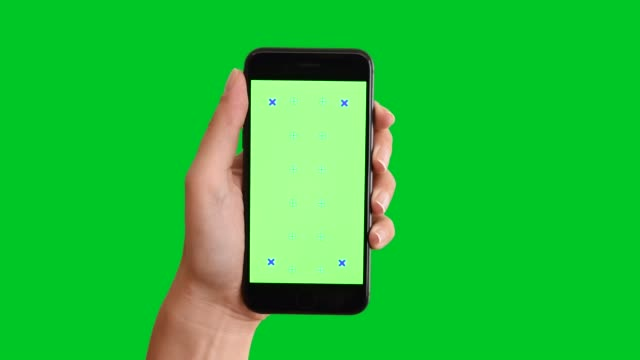 4k using smart phone displaying chroma key on green screen - scrolling stock videos & royalty-free footage
