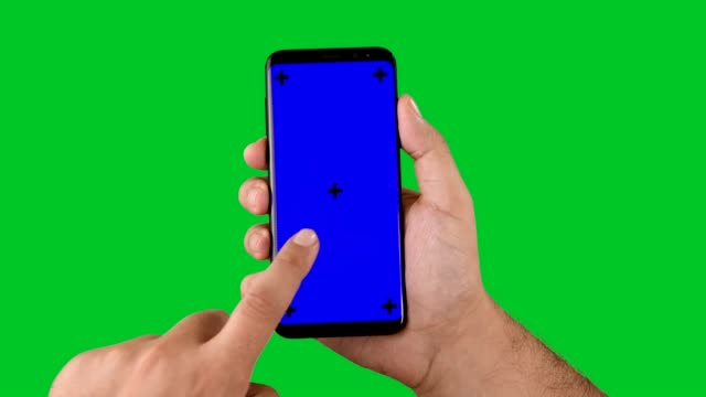 4k using smart phone displaying chroma key on green screen - tapping stock videos & royalty-free footage